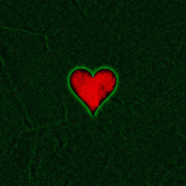"""Red grunge heart on a dark green background"" stock image"