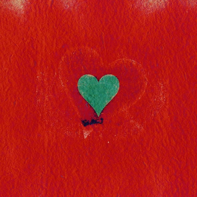 """Green heart on a red grunge background"" stock image"