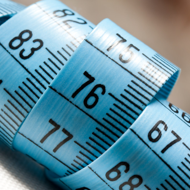 """Blue plastic tape measure coil"" stock image"