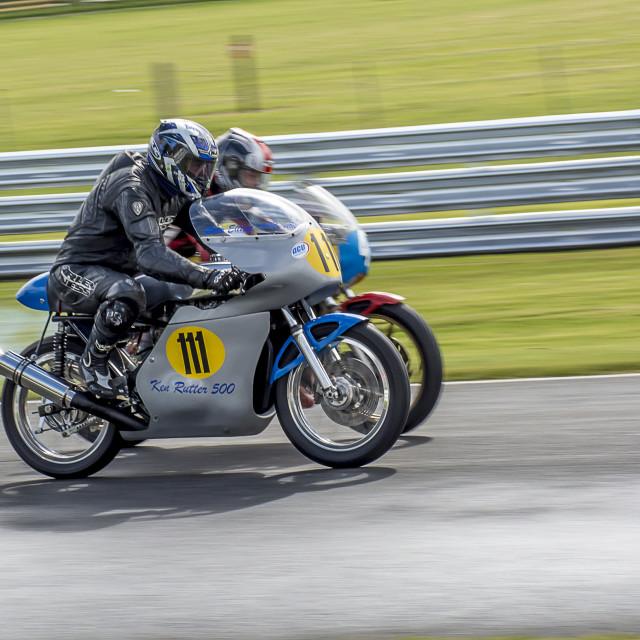 """Vintage Racer man and bike"" stock image"