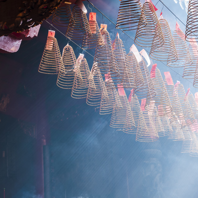 """Burning incense coils in an ancient pagoda in Ho Chi Minh City"" stock image"
