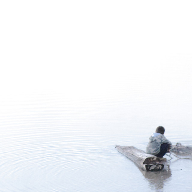 """Ripples of Meditation, Boy and Dog"" stock image"