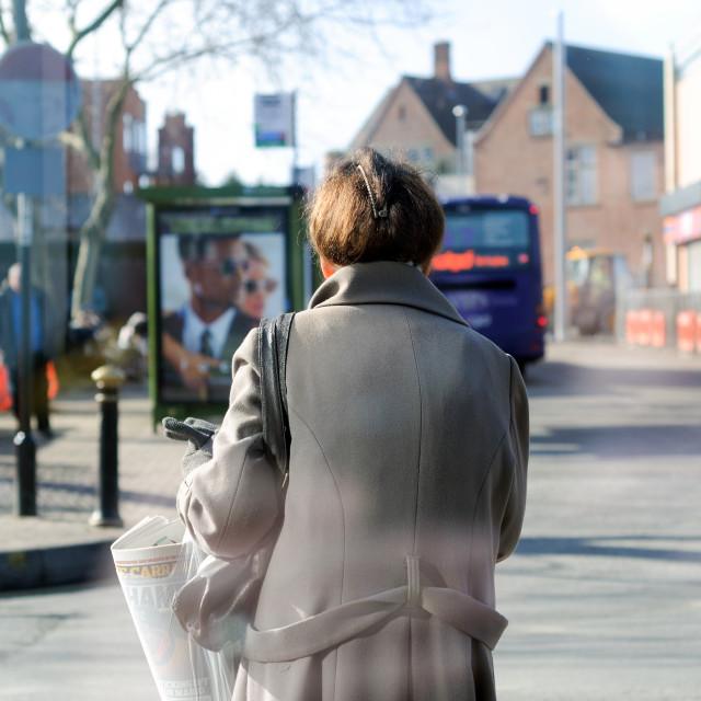"""Woman Waiting At Bus Station"" stock image"
