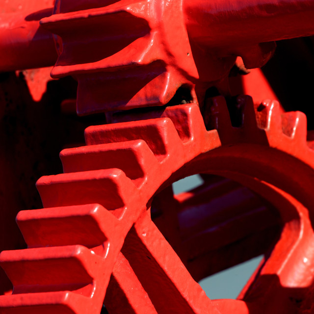 """""""RED PAINTED COG WHEELS"""" stock image"""