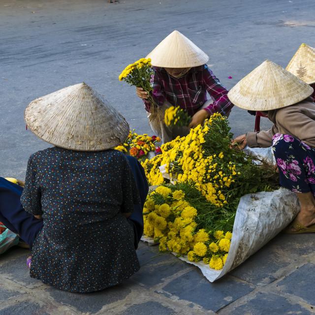 """""""Vietnamese senior women exchange for flowers"""" stock image"""