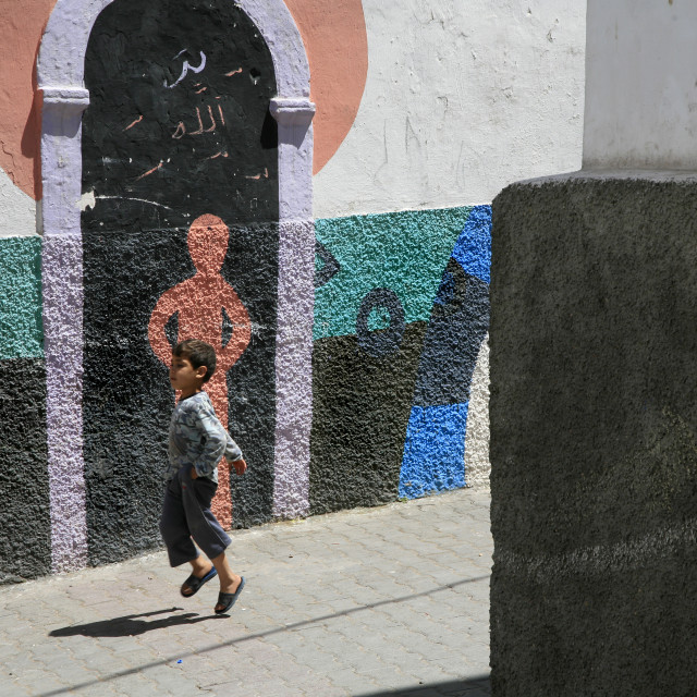 """Child running in the Medina of Azemmour, (Greater Casablanca), Morocco."" stock image"