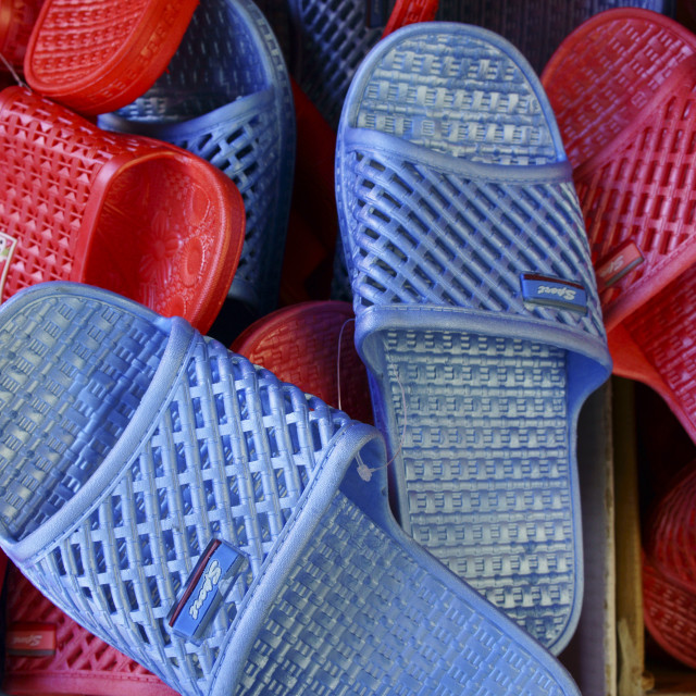 """Colourful plastic slip-on sandals"" stock image"