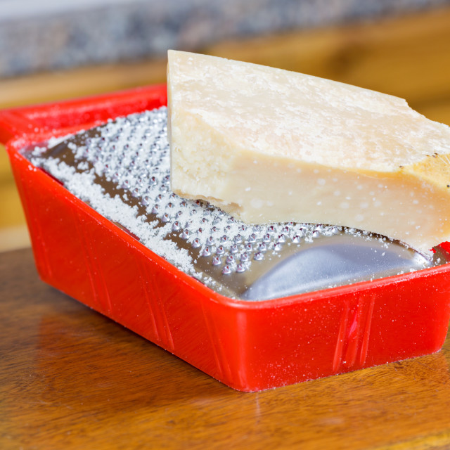 """""""Parmesan cheese on grater"""" stock image"""
