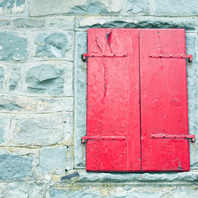 """""""red shutters in an old window"""" stock image"""