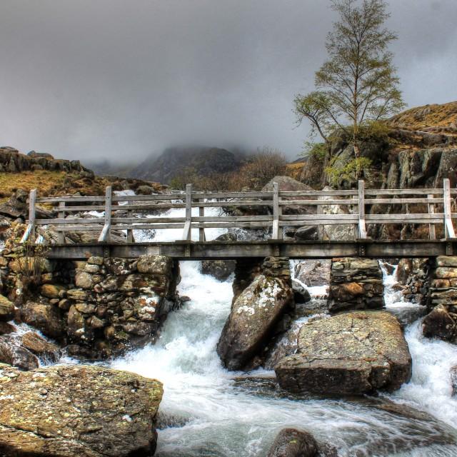 """Footbridge over waterfall at Cwm Idwal"" stock image"