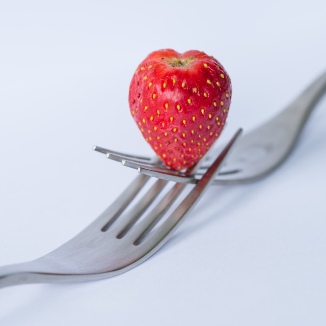 """Strawberry on forks"" stock image"