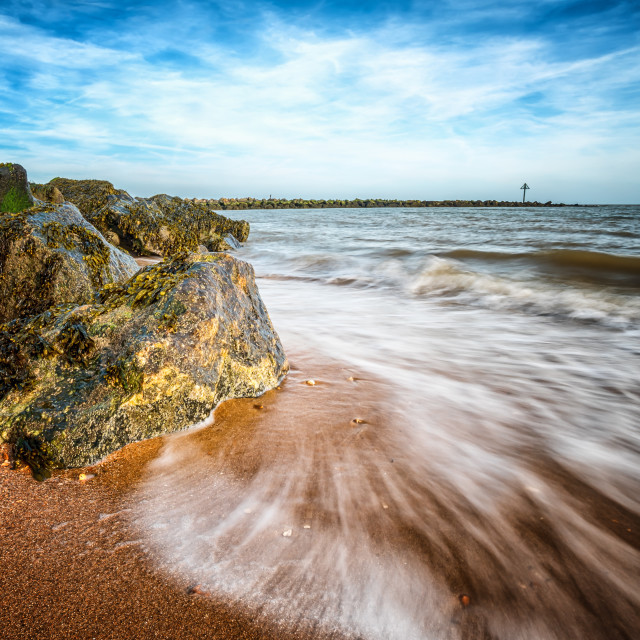 """Incoming waves on an ebbing Tide"" stock image"