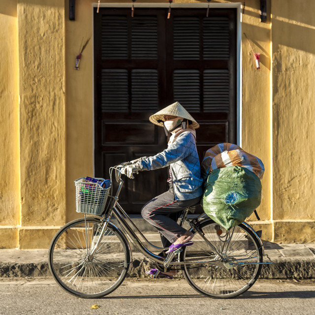 """Vietnamese woman drives bicycles."" stock image"
