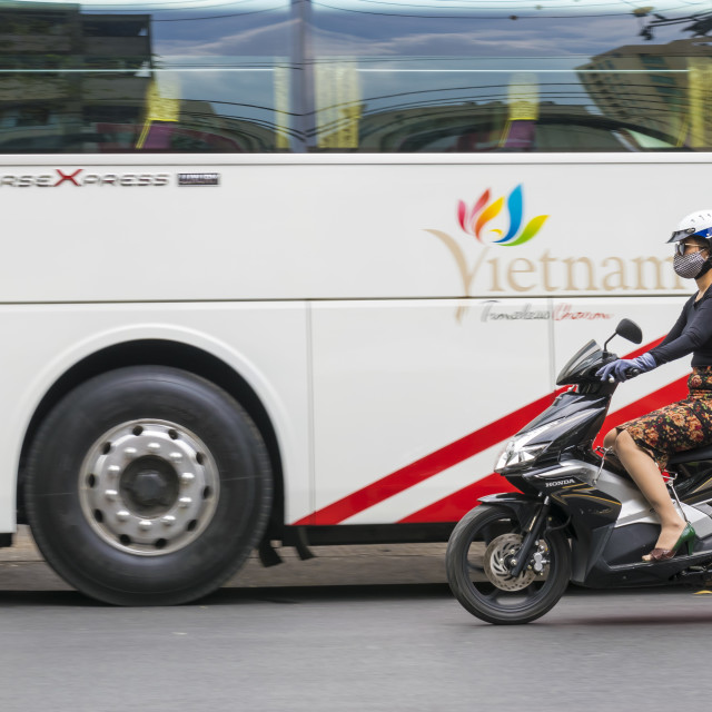 """""""Young Vietnamese woman drives motorbikes on the road of Ho Chi Minh City"""" stock image"""