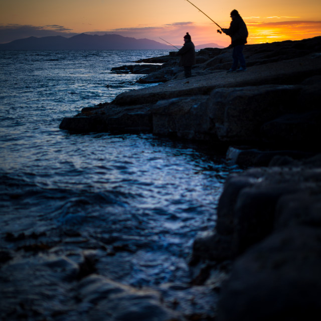 """Troon anglers after sunset"" stock image"