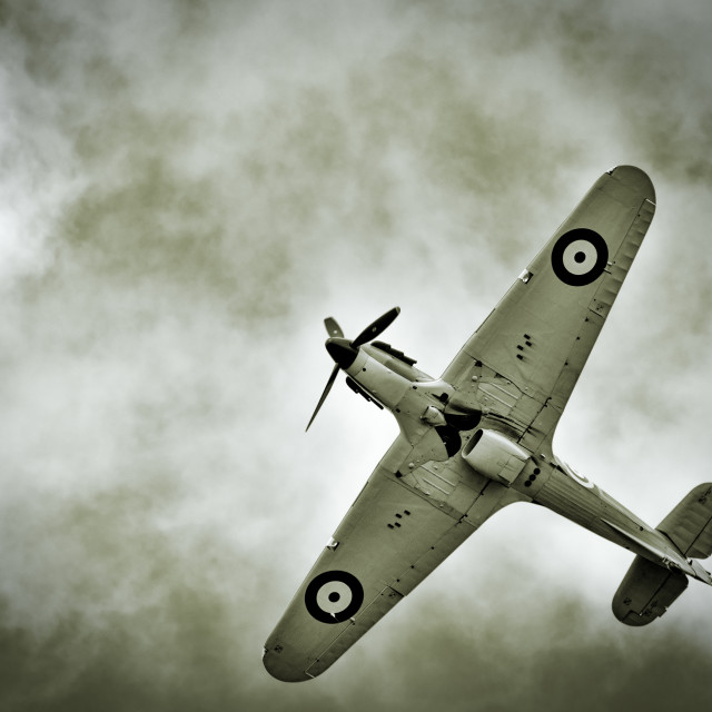 """WW2 Hawker Hurricane fighter against dark clouds"" stock image"