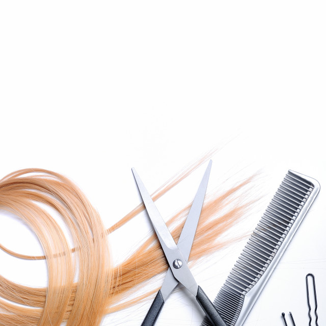 """""""Barber scissors and comb with lock of blonde hair isolated"""" stock image"""