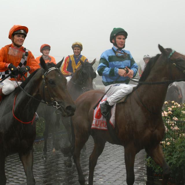 """Jockeys in the rain."" stock image"