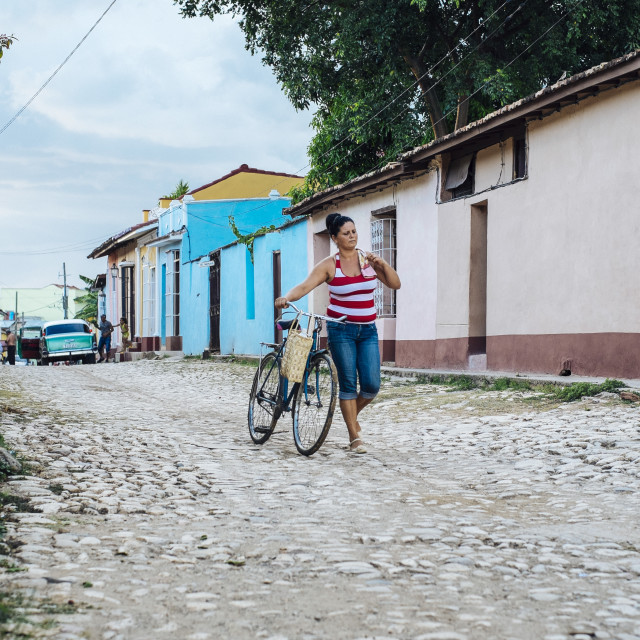 """Women with bike in Trinidad Cuba"" stock image"