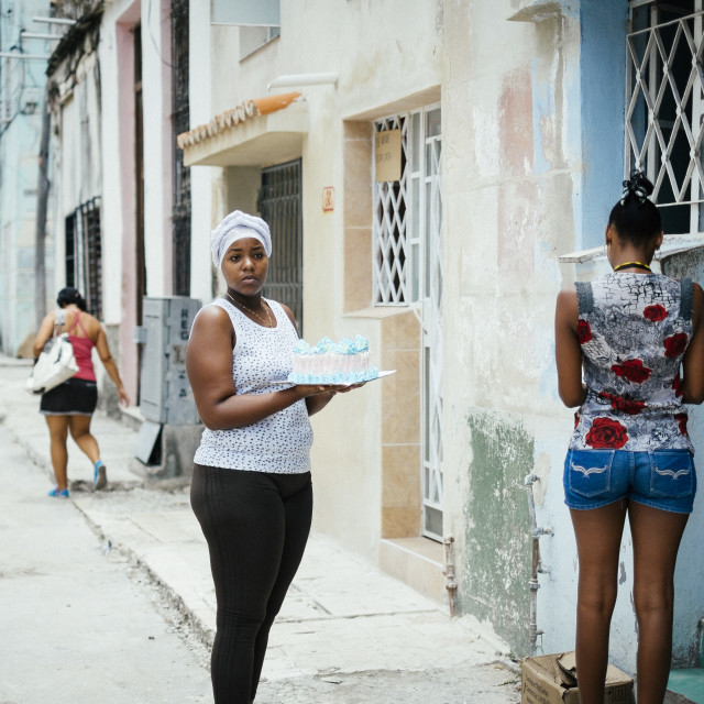 """A local Cuban women holding a cake"" stock image"