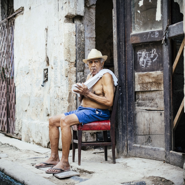 """A local man smoking a cigar in Old Havana Cuba"" stock image"