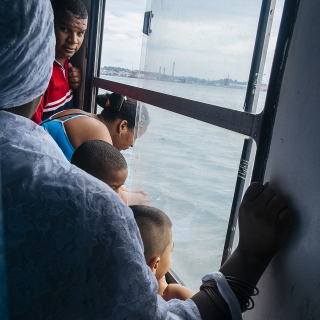 """People looking out from a water ferry in Havana Cuba"" stock image"