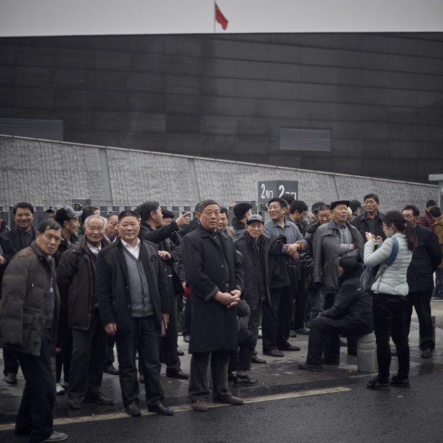 """Men waiting at Nanjing Massacre Memorial"" stock image"