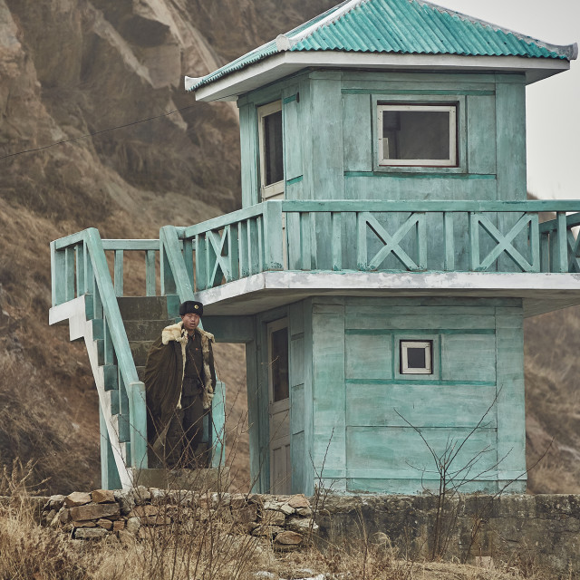 """North Korean Border Guard and watchtower"" stock image"