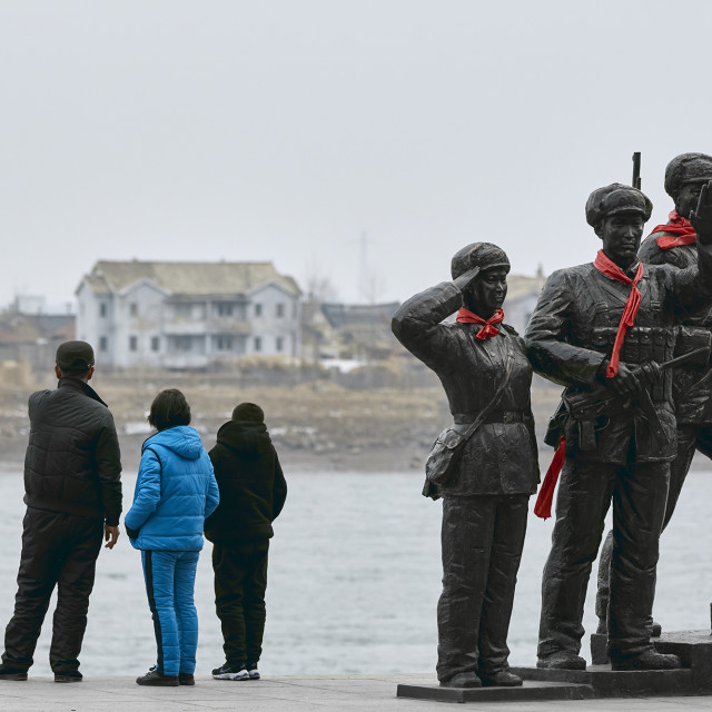 """""""Chinese Tourists looking into North Korea"""" stock image"""