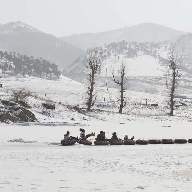 """Chinese tourists on frozen Yalu River, North Korea"" stock image"
