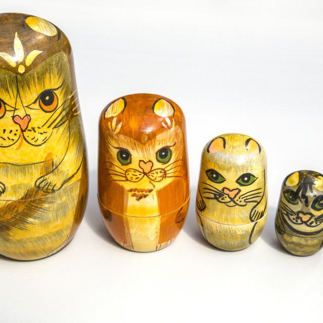 """Russian Dolls - Cats in a Row"" stock image"