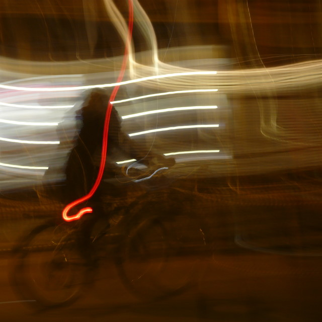 """Woman on bicycle at night in Oxford with light trails"" stock image"