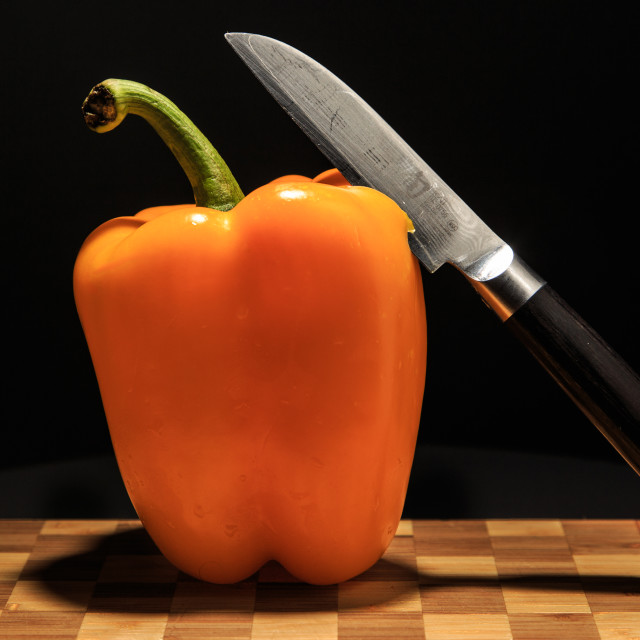 """Yellow Pepper and Japanese Style Knife"" stock image"