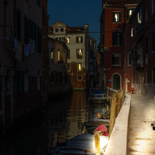 """""""Venice canal with boats at night."""" stock image"""
