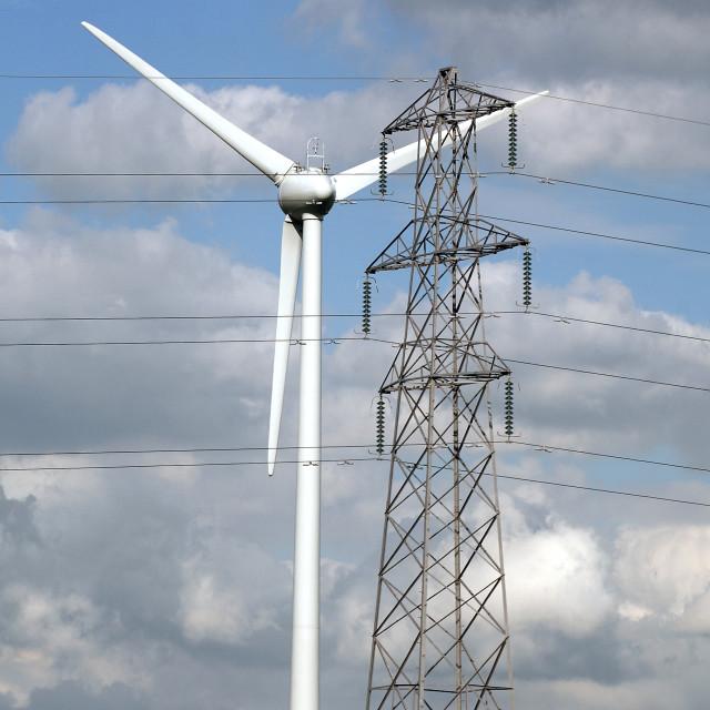 """ELECTRICITY PYLON WITH WIND TURBINE"" stock image"