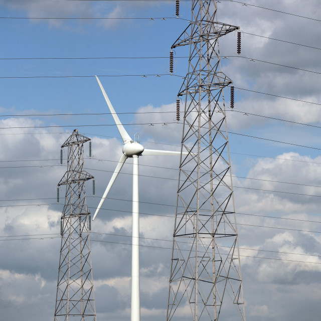 """ELECTRICITY PYLONS WITH WIND TURBINE"" stock image"