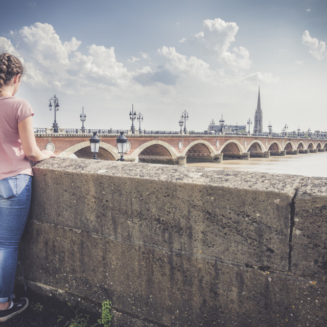 """Girl looking at Bordeaux"" stock image"