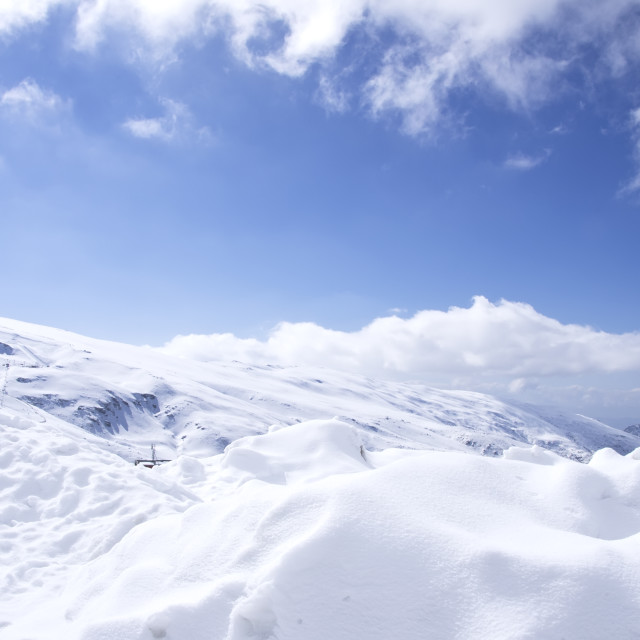 """Panorama of Snow Mountain Range Landscape with Blue Sky"" stock image"