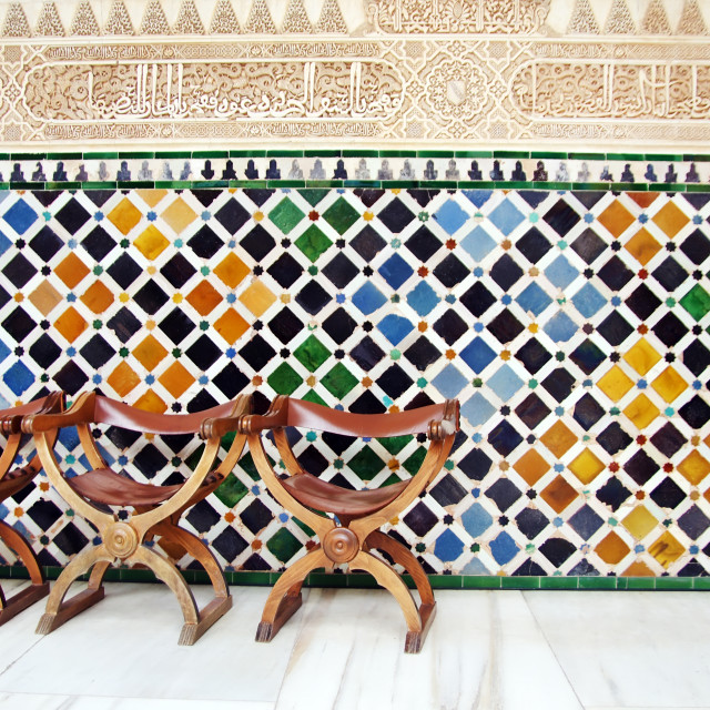 """""""Chairs and the wall of tiles in The Alhambra, Granada, Spain"""" stock image"""