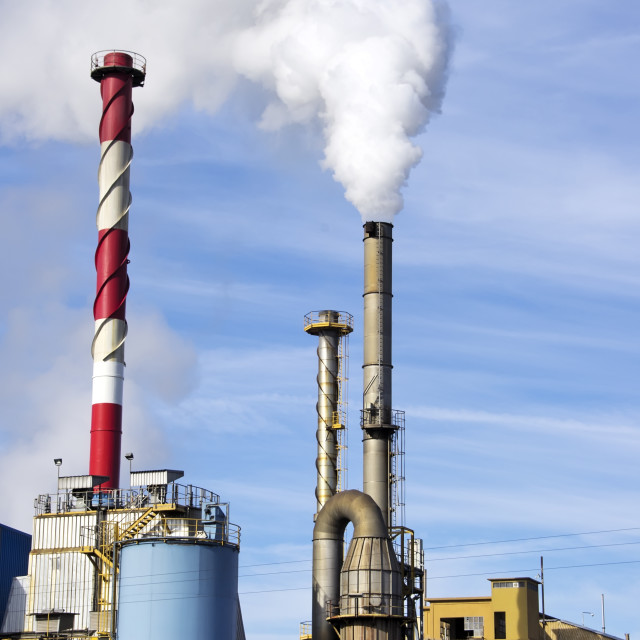 """industrial factory with tall fume towers"" stock image"