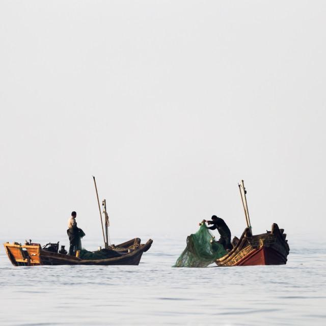 """Early Morning Fishing in Qingdao, China"" stock image"
