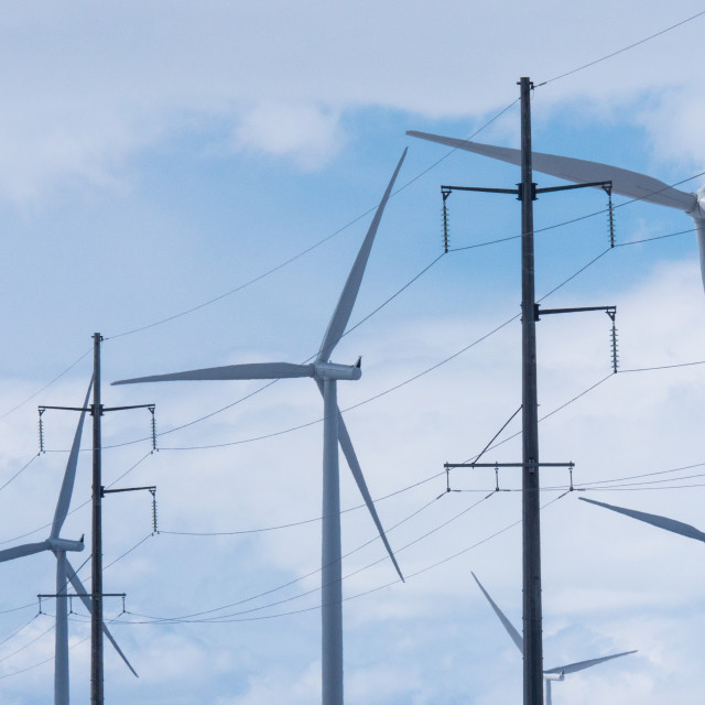 """Wind turbines with electricity power pylons"" stock image"