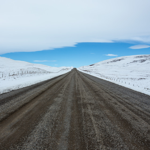 """Gravel road and winter landscape"" stock image"