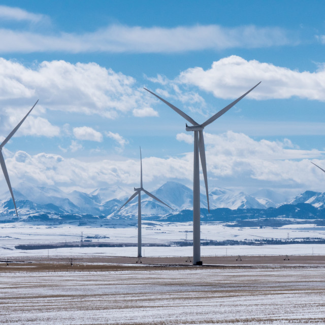 """Wind Turbines with Rocky Mountains in the Winter"" stock image"