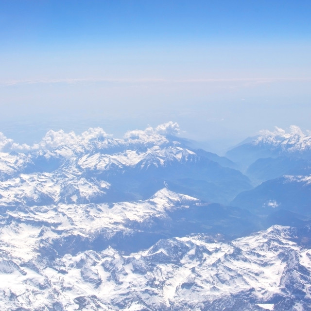 """""""Aerial view of snow clad mountains"""" stock image"""