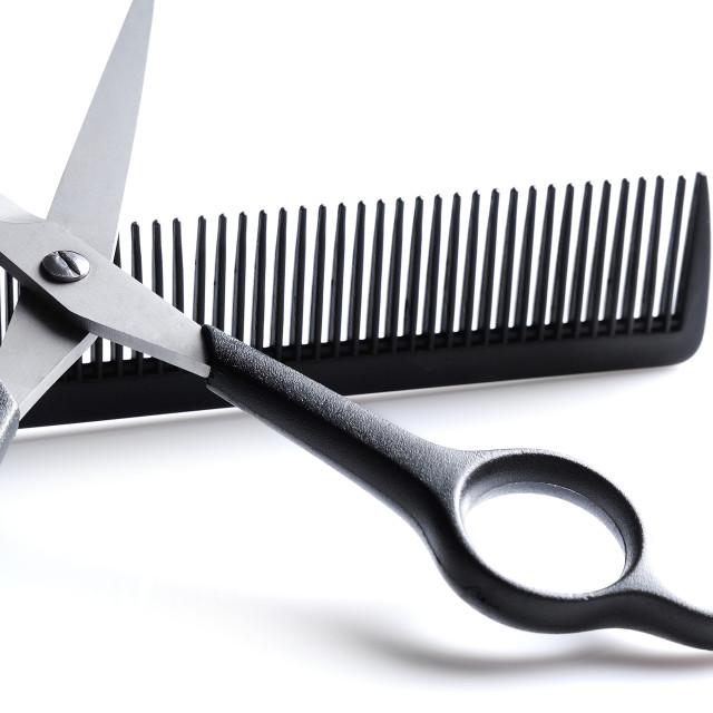 """Scissors resting on barber comb closeup"" stock image"