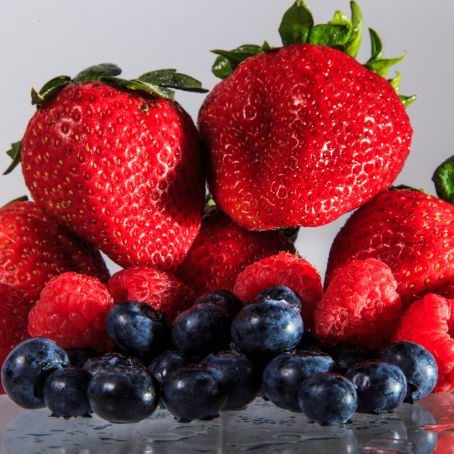 """Still Life of Strawberries, Raspberries and Blueberries"" stock image"