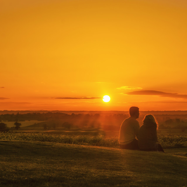 """Couple watching the sunset"" stock image"