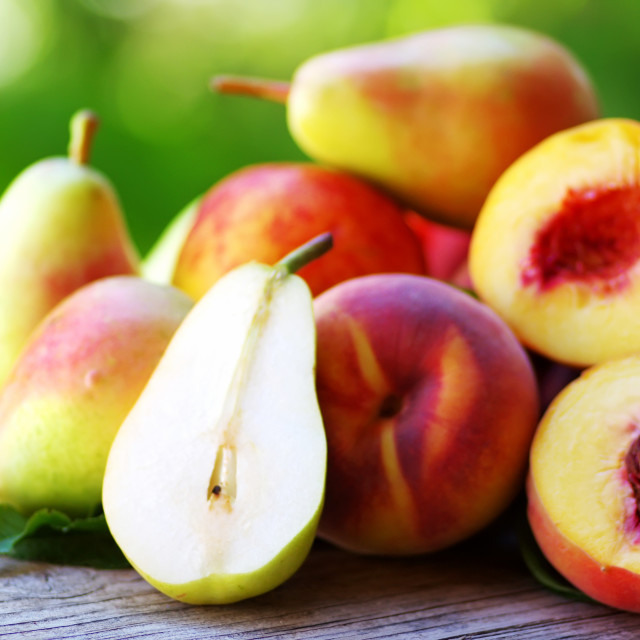 """Ripe pears and peaches on table"" stock image"