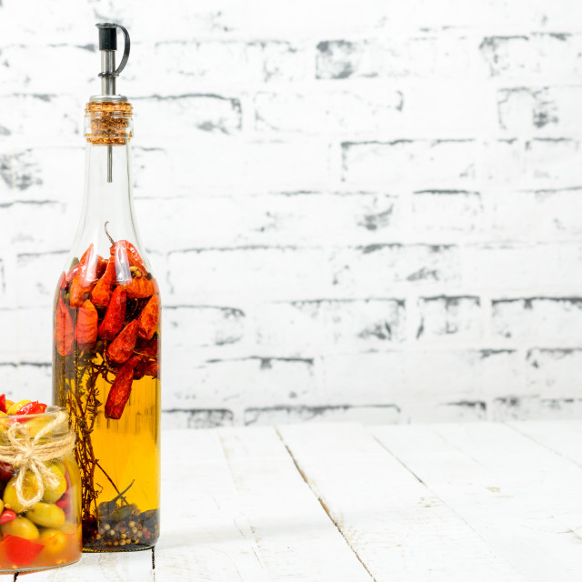 """olives and hot pepper sauce in a bottle"" stock image"